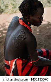 DASSANECH VILLAGE, OMORATE, OMO VALLEY, ETHIOPIA - AUGUST 11, 2018 : Woman from the african tribe Dassanech tribe poses for a portrait