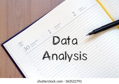 Data analysis text concept write on notebook with pen