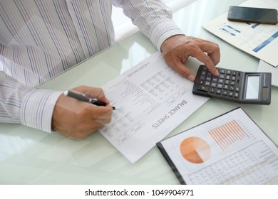 data analyst analyzing business report for assessment and evaluation performance.