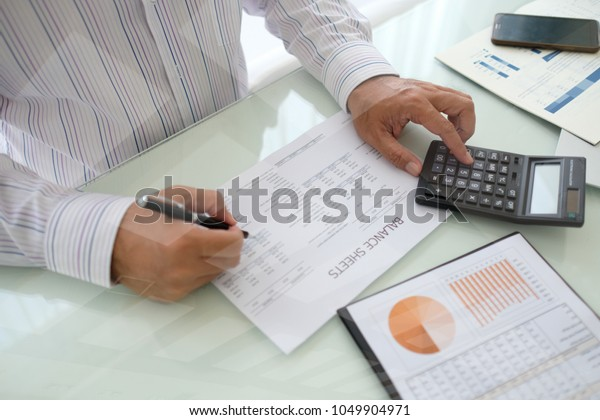 Data Analyst Analyzing Business Report Assessment Stock