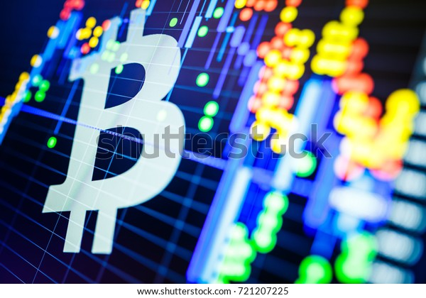 Data analyzing in exchange stock market: the candle chars on display. Analytics price change cryptocurrency BTC to USD (Bitcoin / US Dollar), the most popular pair in the world. Big Bitcoin logo.