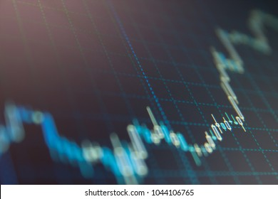 Data analyzing in forex market: the charts and quotes on display. Stock market graph on the screen. Professional market analysis. Bitcoin market graph on the screen. Finance concept.