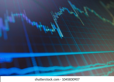 Data analyzing in forex market: the charts and quotes on display. Finance stock market investment trading. Stock market concept and background.