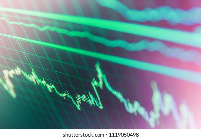 Data analyzing in forex market: the charts and quotes on display. Online forex data. Bullish point, Bearish point trend of graph. Stock market quotes on display. Blue background with stock chart.