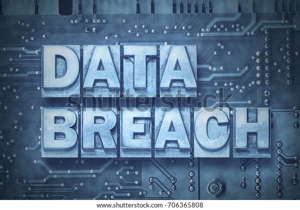 data breach made from metallic letterpress blocks on the pc board background