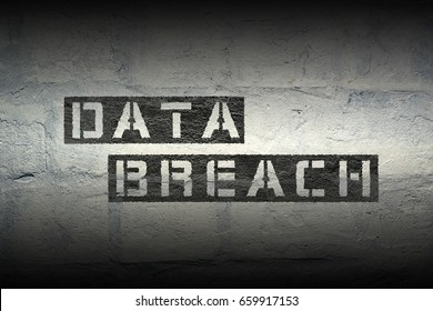 data breach phrase stencil print on the grunge white brick wall