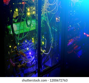 Data center in the night. Dark room with light from telecommunication lights.