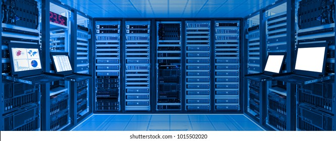 Data center room with server and networking device on rack cabinet, kvm monitor screen display chart, log and blank screen