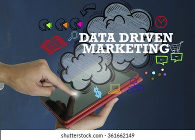 DATA DRIVEN MARKETING over a tablet computer on dark blue background , business concept , business idea