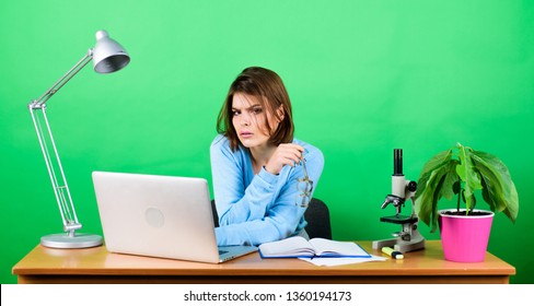 data and information. Business woman. chemist biologist with microscope on table. digital science. woman work in office on laptop. tired secretary at workplace. Check out my profit this month.