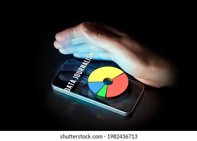 Data journalism media concept with smart phone and graph. Data journalism is a type of journalism working with numerical data and their interpretation with infographics and data visualization.