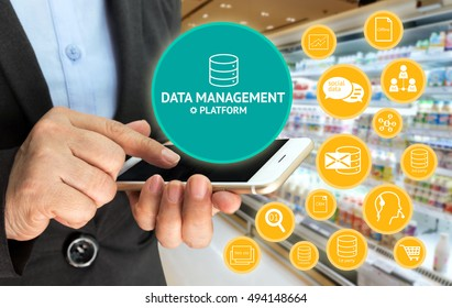 Data Management Platform (DMP) concept. Infographic , texts and icons on supermarket and woman holding mobile phone background. Marketing and crm concept