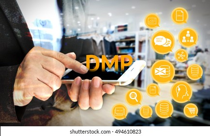 Data Management Platform (DMP) concept. Infographic , Double exposure effect of texts and icons in retail store hand holding mobile phone background. Marketing and crm concept