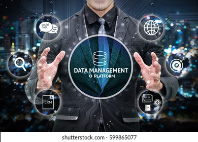 Data management platform and future marketing concept.  Man business suit hand , Electric circuit graphic and info graphic of dmp technology icons.