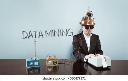 Data mining concept with vintage businessman and calculator at office