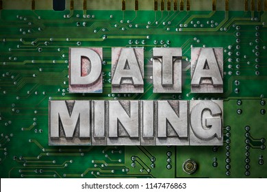 data mining phrase made from metallic letterpress blocks on the pc board background