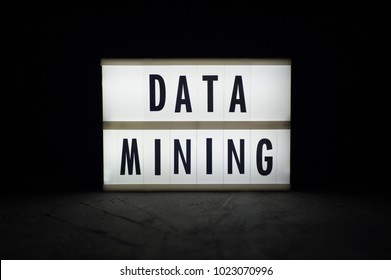 Data mining - text on a luminous display in the dark. Cryptocurrency news.