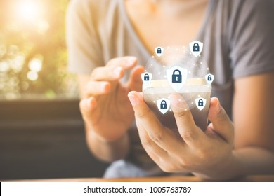 Data protection and security important information in your mobile phone, Woman hand using smartphone and icon key on shield