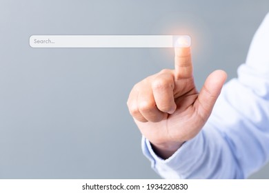 Data search engine optimization browser  webpage technology internet networking business concept, Search browsing internet connecting worldwide gray background, hand touching search bar business.