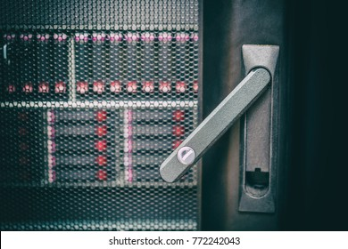 IT data security vulnerability concept. Opened server rack door close up. Storage disks in the rack