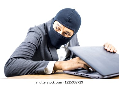 Data theft, Computer hacker stealing data and personal identity information off a laptop computer, Data center security policy