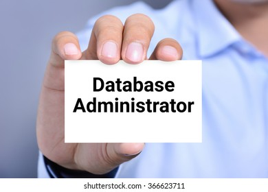 Database Administrator, words on the card shown by a man