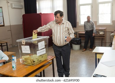 At Datca, Mugla, Turkey- April 16, 2017:  Referendum in Turkey, man using vote in Kazim yilmaz elemantary school in Datca, Mugla, Turkey.