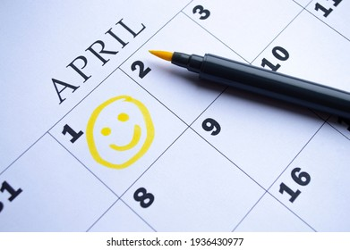 The date of April 1 is circled on the calendar close up. April Fool's Day - Shutterstock ID 1936430977