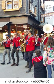 Date; April 5, 2017, a band of Swiss musicians played festive music with fun and melodious music on sunny day in Zermatt city in Switzerland