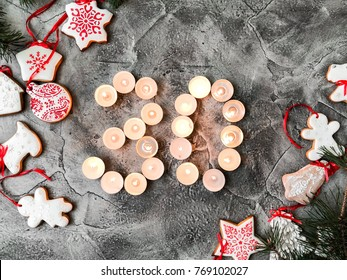 Date in calendar. December day. Christmas is coming. Advent. New Year and Christmas background. Number from candle light. Homemade Christmas cookies. 30 of december