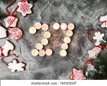 Date in calendar. December day. Christmas is coming. Advent. New Year and Christmas background. Number from candle light. Homemade Christmas cookies. 27 of December