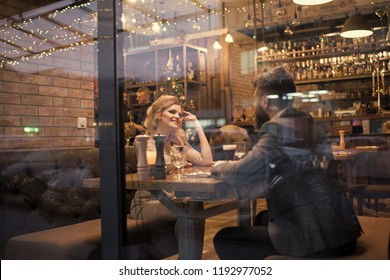Date of family couple in romantic relations, love. Valentines day with sexy woman and bearded man. Proposal and anniversary. Business meeting of man and woman. Couple in love at the restaurant