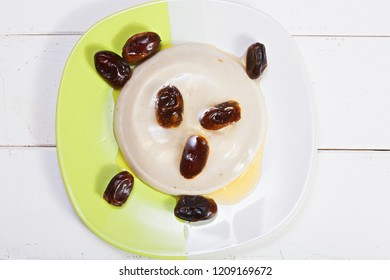 Date fruit jelly dessert with honey. Horizontal overhead shot