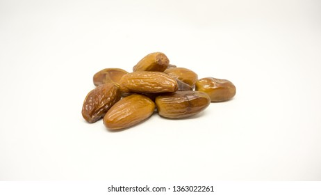 Date fruit is the sweetest fruit and a part of staple diet in Middle Eastern countries. These are dried dates isolated on white background