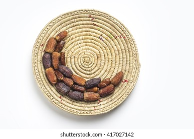 Date fruits arranged in moon shape on a straw plate. Islamic festive food and it's significance.