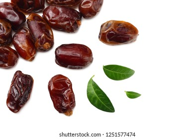 date fruits with green leaves isolated on white background. top view