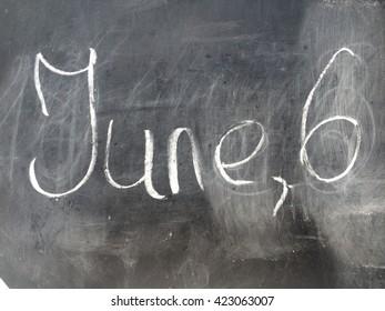 Date June 6 on the black chalkboard