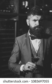 Date meeting of hipster awaiting in pub. bar customer sit in cafe drinking alcohol. Businessman with long beard drink in cigar club. Perfect wine. Bearded man rest in restaurant with wine glass.