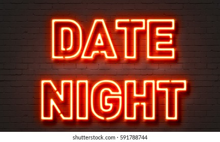 Date night neon sign on brick wall background