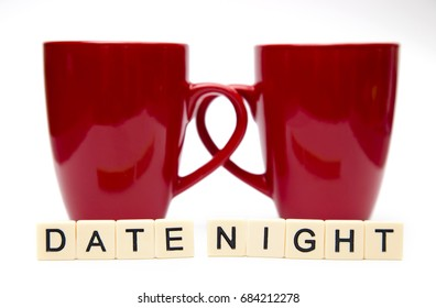 Date Night Spelled out in Tiles with Two Coffee Mugs
