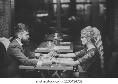 Date at the restaurant. Couple in love at the restaurant. Date of family couple in romantic relations, love. Valentines day with sexy woman and bearded man. Business meeting of man and woman.