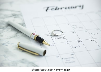 The date of the wedding marked on the calendar. Next to the wedding ring