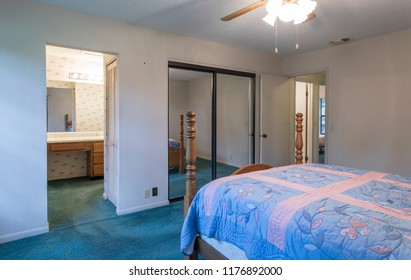 Dated 1980s bedroom interior in residential setting
