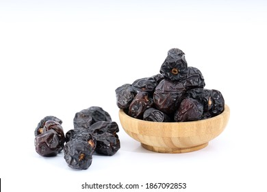 dates, ajwa dates on white surface
