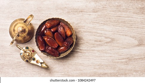 Dates with arabic coffee pot top view