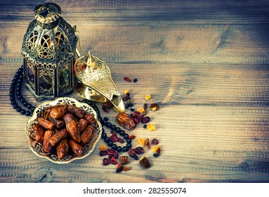 Dates, arabic lamps and rosary. Islamic holidays decoration concept. Vintage style toned picture