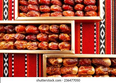 Dates arranged on Arabian woven fabric. Dates symbolise Arabian hospitality
