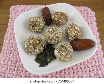 Dates confection balls with oats, carob and pumpkin seeds