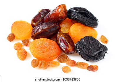 Dates, dried apricots, prunes, raisins on a white background
