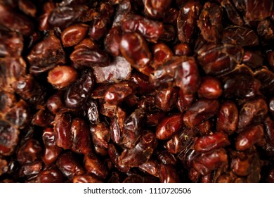 dates for food textures. dates on the shelf in the store. dates. Date fruit closeup background. Heap of dried shiny brown red date fruit. Top view. delicious date fruit - ramadan